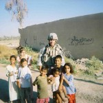 Sergeant Paul Kendel with Iraqi children