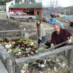 Megan Connolly and Sonja Tobiessen work the compost