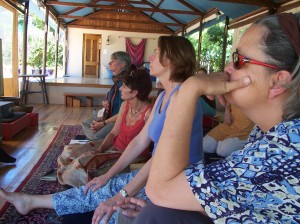 Listening to Shambhala Training talk by Acharya David Hope. Chris de Block (Assistant Director), Myrna Lewis, Jenny Birkett and Helen Douglas (left to right). Photo by Jennifer Woodhull.