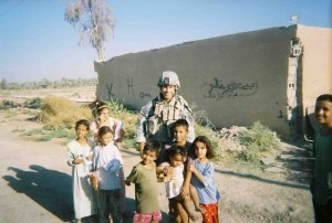 Sergeant Kendel with Iraqi children
