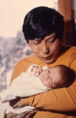 Trungpa Rinpoche with Taggie Mukpo. Photo by Blair Hansen. Courtesy of Shambhala Archives.