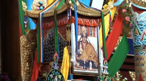 Ornamental container holding the bodily remains (kudung) of His Holiness Penor Rinpoche, placed on a gilded throne at Namdroling Monastery.