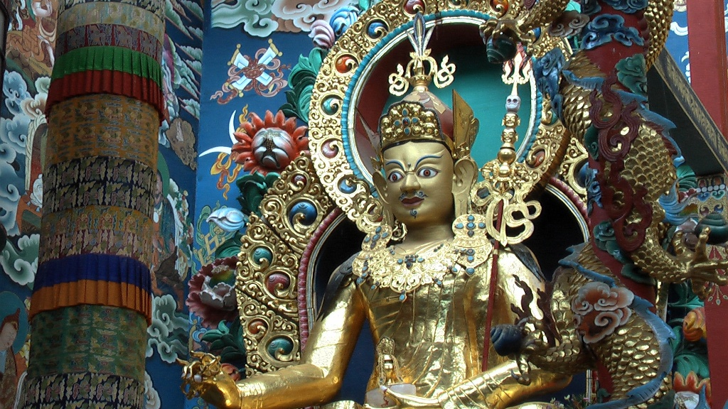 A 60-foot-high rupa of Padmasambhava is one of three huge gold statues that gaze down over the assembly of practitioners in the Golden Temple.