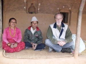 Tom Bell with his hosts, Mr. & Mrs. Thapa