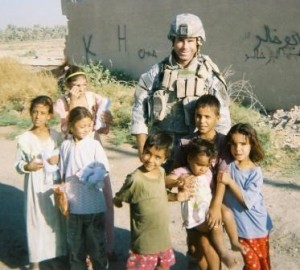 Sgt. Paul Kendel with Iraqi children