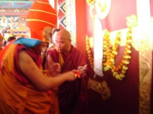 His Holiness the Dalai Lama cuts the ceremonial ribbon to open Rigon Thupten Mindroling Monastery, seat of the Ripa Lineage in Orissa, India.