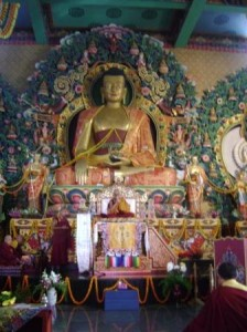 The central rupa of Shakyamuni Buddha in the main shrine hall of the monastery gazes down over the assembly as His Holiness presides over the opening rituals.