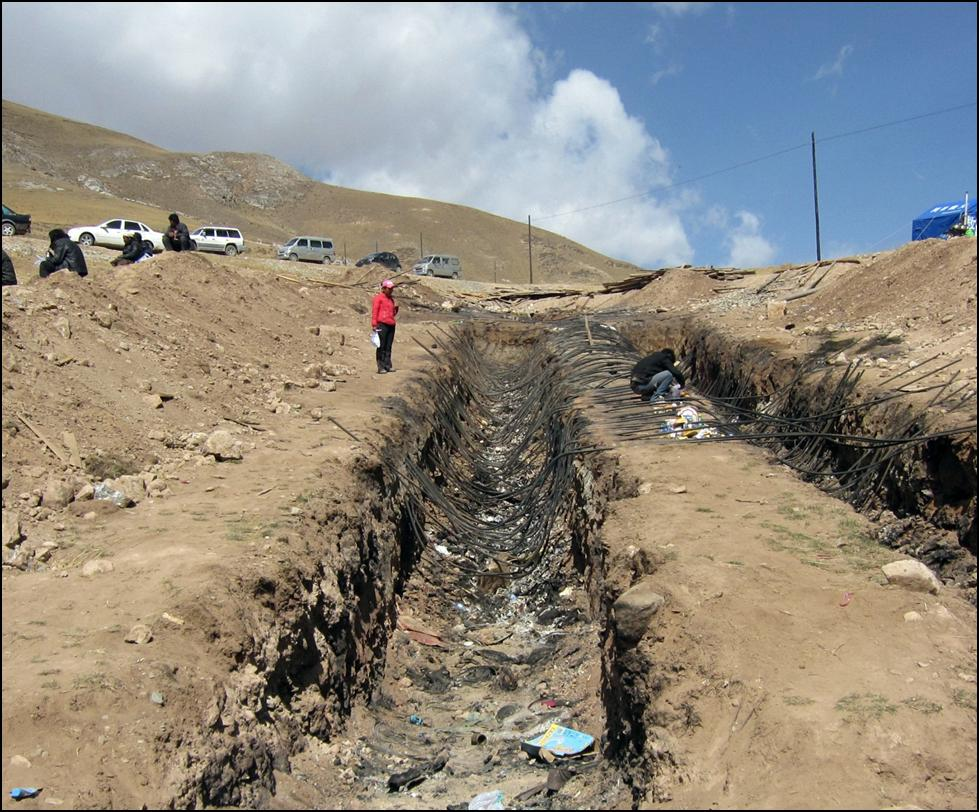 jyekundo earthquake photo essay by khenpo tsering shambhala the trenches near jyegu monastery where many hundreds of those who died in the earthquake were cremated together the rebar on which the bodies were laid