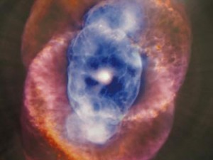 Cat's Eye. This object reflects a stage of evolution our own sun will experience in several billion years. When a sun-like star begin to run out of fuel, it sheds some of its outer layers while leaving behind a white-hot core