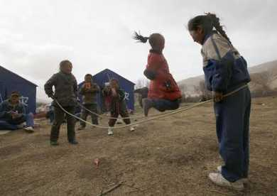 Children playing outside makeshift tents, photo by Kontargyal