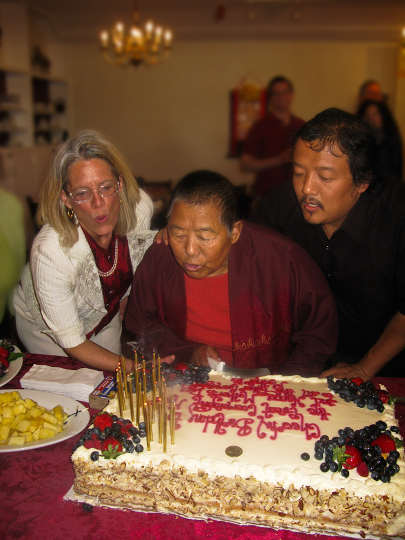 Lady Konchok blows out the candles of her cake on Mother's Day at Marpa House, photo by Tharpa Chotron