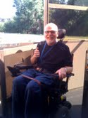 Larry, in his power wheelchair, leaving the elevator on the outside of the Denver Center.