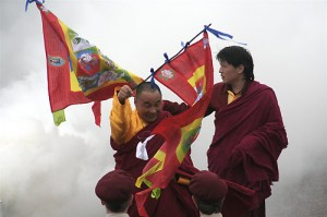 Karme Senge Rinpoche and Lhunpo Rinpoche at the lhasang for the wedding of Sakyong Mipham Rinpoche and Khandro Tseyang, holding Gesar flags; photo by Michael Wood, courtesy of the Nalanda Translation Committee