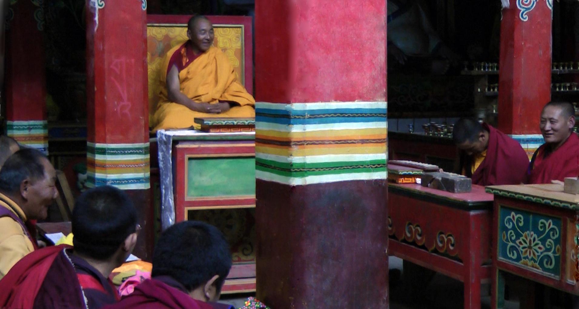 Karma Senge Rinpoche and monks reciting the Kagyu Gurtso at Surmang