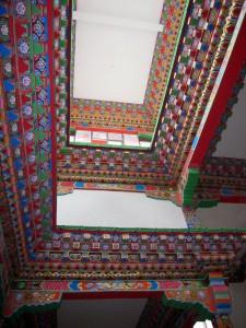 Elaborate painting of the shedra shrine room clerestory, November 2010