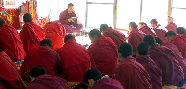 Trungpa XII Rinpoche teaching novice monks at the Surmang shedra, October 2010