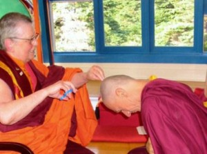 The author receiving lay precepts from Ani Tsultrim Palmo.
