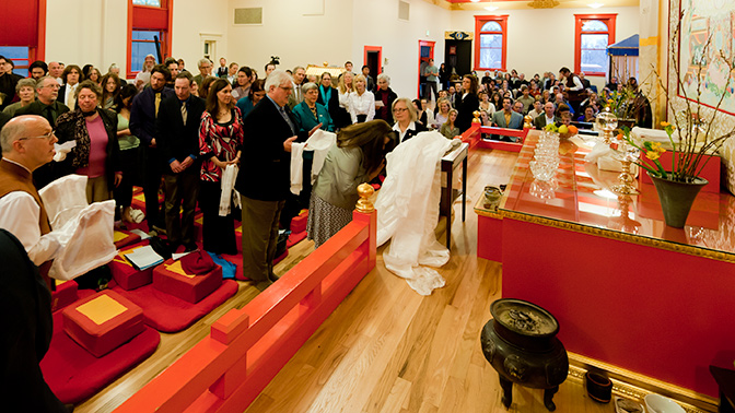 The Boulder community offer khatas in front of the new Ridgen thangka.