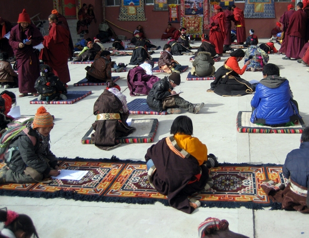 Children taking exams at Surmang Shedra to bring in the New Year