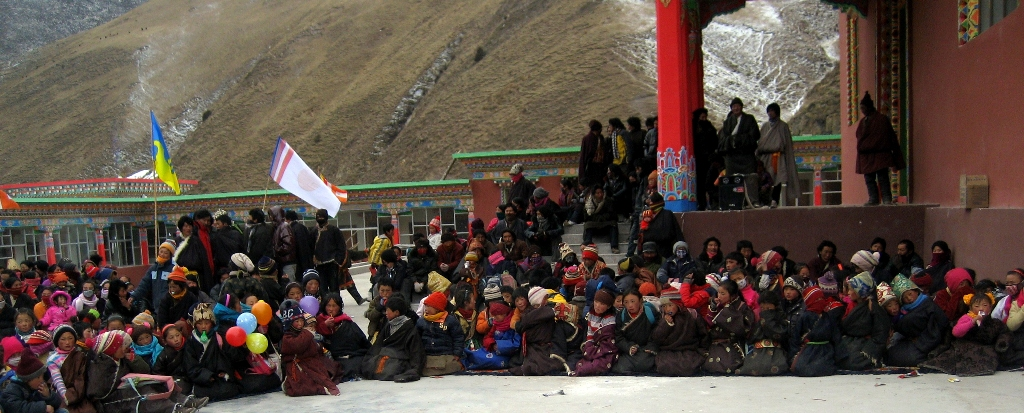 The Shambhala flag and Karmapa dream flag fly above the Losar celebrations at Surmang.