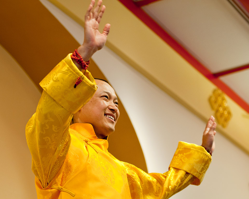 Sakyong Mipham Rinpoche greets a cheering crowd on Shambhala Day