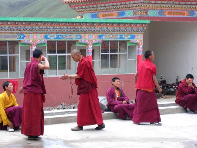 Monks debating in the shedra courtyard.