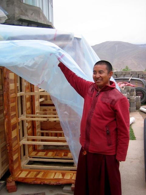 Surmang Khenpo shows beds from juniper wood in storage in Jyekundo.