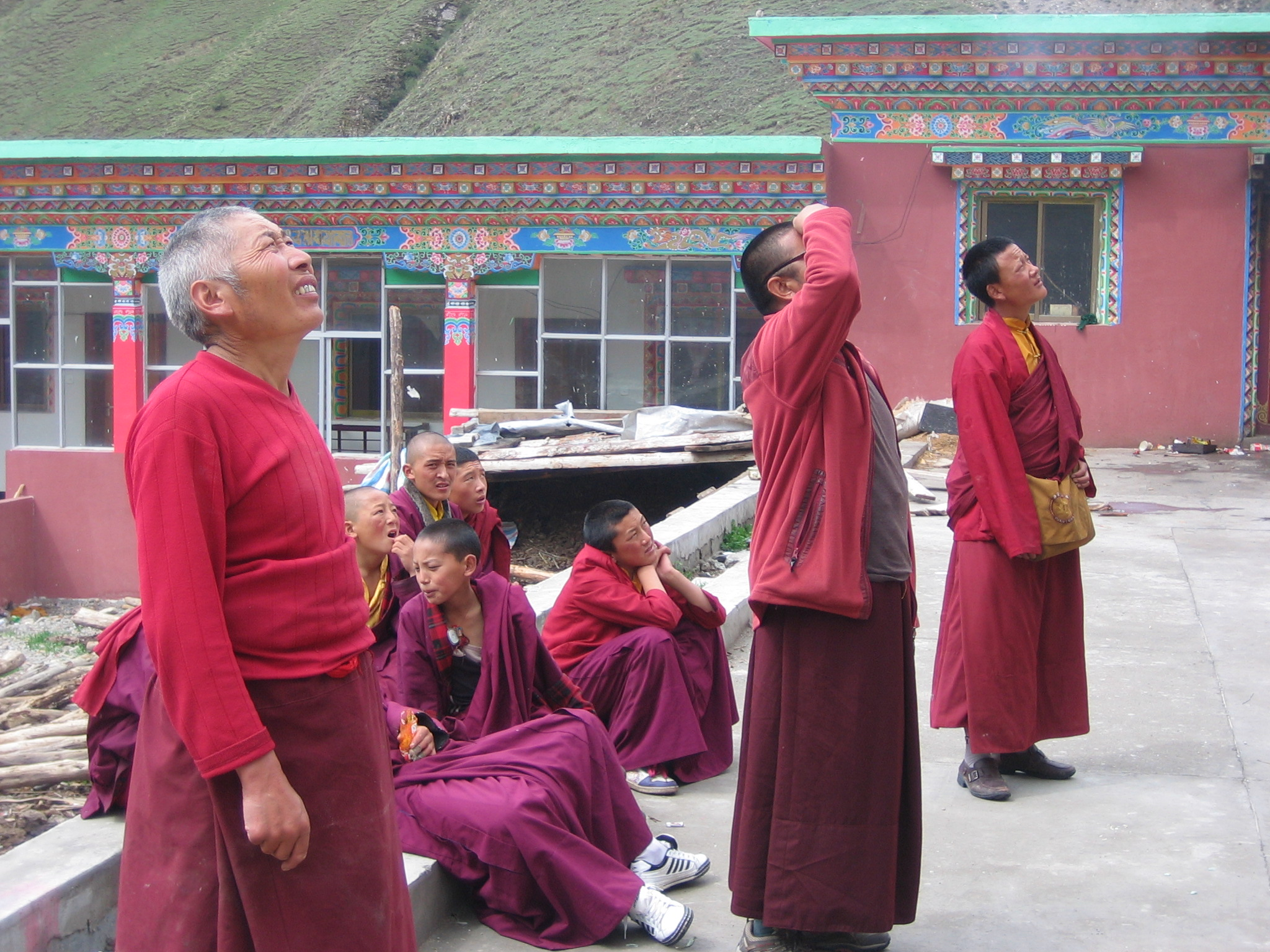 Monks spontaneously gather to watch the first medallions installed.