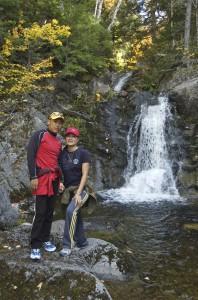 Sakyong and Sakyong Wangmo by Kalapa Valley waterfall