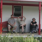 On the Karme Choling porch: Kevin Hoagland, Anthony Miller, Meta Maertens