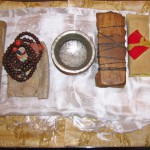 Left to Right 1) Mipham the Great's text , 2) the Vidyadhara's mala 3) Mipham the Great childhood drinking bowl 4)Vidyadhara's handwritten chant book 5) The Sakyong's childhood chant book saved by his mother