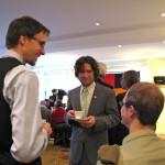 Acharya McLellan and Jeff Torbert chat while enjoying tea