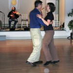 Ashe Acharya John Rockwell and Rhiannon Wells waltzing at end of a Midsummers contra dance