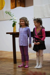 Eva and Maya performing for the assembly