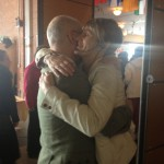 President Richard Reoch hugs outgoing Director of Shambhala Online, Heather Scott