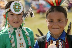 Saskatchewan_First_Nations_Children_at_Wanuskewin_Heritage_Park_staring_into_camera