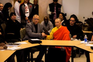 The Sakyong shaking hands with Tio Hardiman the Director for CeaseFire Illinois