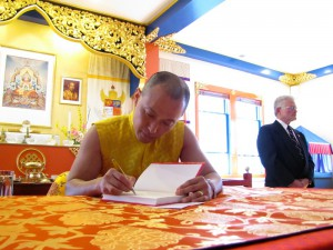 Sakyong Mipham signs a copy of The Shambhala Principle