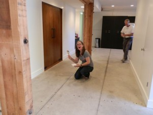 West side coordinator Anne Saitzyk and contractor Dennis Bradford put finishing touches on the new center in Los Angeles.