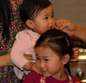 Jetsun Yudra and Jetsun Drukmo share a playful moment on Children's Day