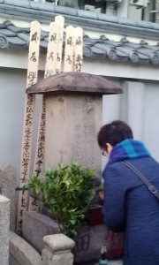 Sister of Sensei offering incense at Shibata family tomb