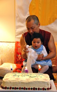 The Sakyong helps Jetsun Yudra blow out the candles on her first cake, photo by Pablo Coddou