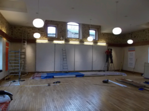 Putting Acoustical Treatment in Drala Hall