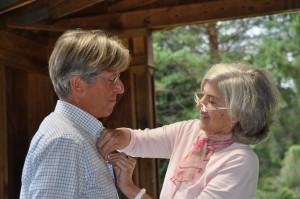 Jane bestows a pin on Mr. Charlie Browne