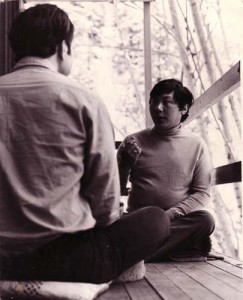 Trungpa Rinpoche giving meditation instruction to a student on the deck of his home on Four Mile Canyon Drive, circa 1970