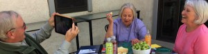 Dave Garton and Nan Clydesdale interviewing Martha Hildreth on her patio