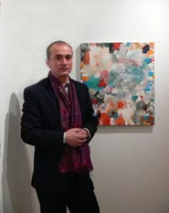 Temo with one of his paintings
