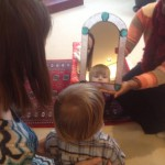 A small sangha member looks into the mirror to see his basic goodness in Boston