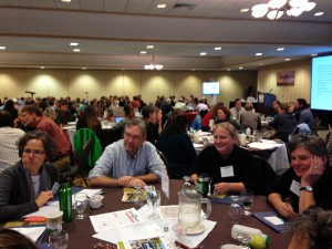 """People talking during a """"Table Talk"""" session at the Annual Vermont Farm to Plate Network Gathering in October, 2014. photo courtesy of Vermont Sustainable Jobs Fund, 2014"""