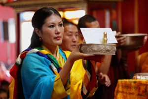The Sakyong Wangmo with a mandala offering